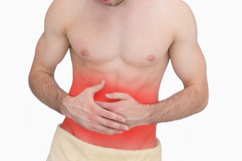 Midsection of man with stomach ache over white background